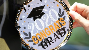 A graduation decoration is shown in Tampa, Fla., on Friday, May 1, 2020. Urmila Persaud spent months picturing herself walking across a stage to collect her high-school diploma in front of friends and family. But the COVID-19 pandemic has replaced that vision with a big question mark as schools and boards across Canada grapple with how to handle graduation ceremonies because of COVID-19 restrictions. THE CANADIAN PRESS/AP-Douglas R. Clifford/Tampa Bay Times via AP