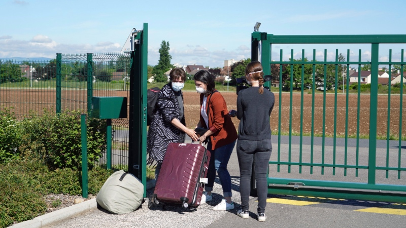 Nurses leave the Vilanova nursing home in Corbas, near Lyon, France, on May 4, 2020. (Laurent Cipriani / AP)