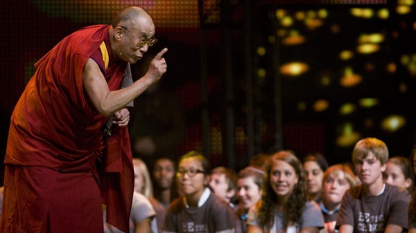 His Holiness the Dalai Lama takes a moment to speak to youth attending We Day in Vancouver, Tuesday, Sept. 29, 2009. (Jonathan Hayward / THE CANADIAN PRESS)
