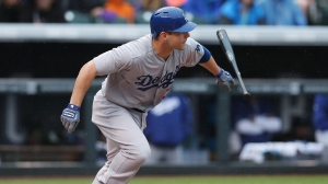 Los Angeles Dodgers' Jamie Romak breaks from the batter's box as he grounds out against the Colorado Rockies in the fourth inning of a baseball game in Denver on Sunday, June 8, 2014. (THE CANADIAN PRESS / AP-David Zalubowski)