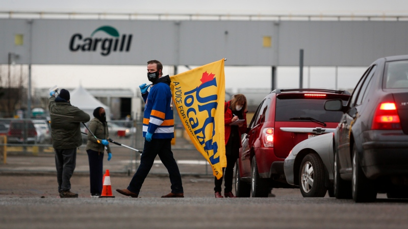 A union representative greets workers returning to the Cargill beef processing plant in High River, Alta., that was closed for two weeks because of COVID-19 Monday, May 4, 2020.THE CANADIAN PRESS/Jeff McIntosh