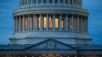 In this May 3, 2020 photo, light shines from inside the U.S. Capitol dome at dusk on Capitol Hill in Washington. The Senate is set to resume Monday, May 4. (AP Photo/Patrick Semansky)