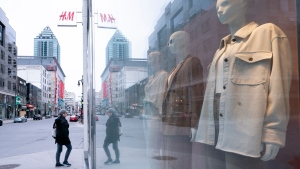 A pedestrian walks down a near empty Sainte-Catherine street in Montreal, on Monday, May 4, 2020. The Quebec government announced that the reopening of retail stores in the greater Montreal area will be delayed by a week, until the week of May 18th. THE CANADIAN PRESS/Paul Chiasson