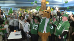 Saskatchewan football fans celebrate the announcement that they Grey Cup is coming to Regina