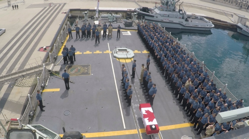 This ship's company from HMCS Fredericton participate in a dignified disembarkation ceremony for their fallen comrades in Taranto, Italy on Sunday. (Cpl. Simon Arcand, Canadian Armed Forces Photo)