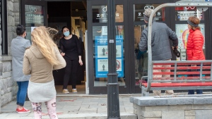 Customers wait to enter a store Monday May 4, 2020 in St. Sauveur, Quebec. Retail stores outside the greater Montreal area have been allowed to reopen after weeks of forced closure due to the COVID-19 pandemic.THE CANADIAN PRESS/Ryan Remiorz