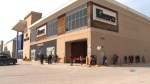 Customers wait outside Polo Park shopping mall on May 4, 2020. (Source: CTV News Winnipeg)