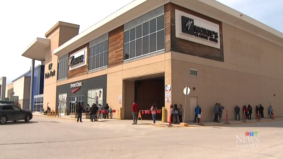 Customers wait outside Polo Park shopping mall on May 4, 2020. (Source: CTV News Winnipeg)