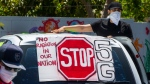 Anti-5G activists stage a demonstration on the steps of The Casa del Mexicano, an 82-year-old cultural center, in opposition to the ongoing construction of 4G/5G cell towers in the Boyle Heights neighborhood of Los Angeles, Saturday, May 2, 2020. (AP / Damian Dovarganes)