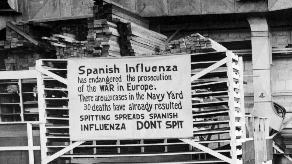 FILE - In this Oct. 19, 1918 file photo provide by the U.S. Naval History and Heritage Command a sign is posted at the Naval Aircraft Factory in Philadelphia that indicates, the Spanish Influenza was then extremely active. Science has ticked off some major accomplishments over the last century. The world learned about viruses, cured various diseases, made effective vaccines, developed instant communications and created elaborate public-health networks. Yet in many ways, 2020 is looking like 1918, the year the great influenza pandemic raged. (U.S. Naval History and Heritage Command via AP)