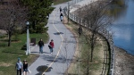 People walking along the Rideau Canal Western Pathway in the midst of the COVID-19 pandemic, in Ottawa on Sunday, May 3, 2020. THE CANADIAN PRESS/Justin Tang