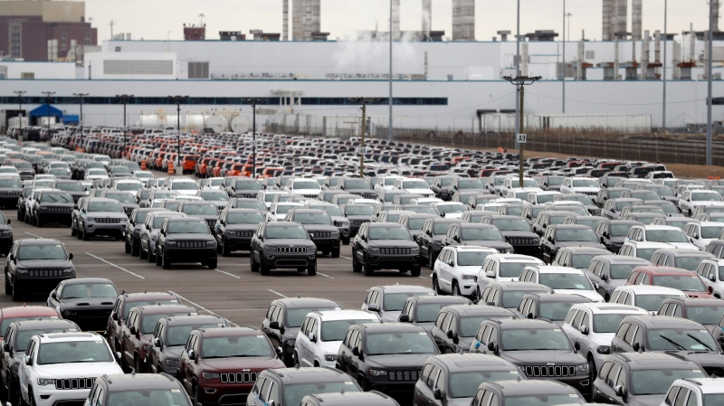 In this Feb. 26, 2019 file photo, Jeep vehicles are parked outside the Jefferson North Assembly Plant in Detroit. (AP Photo/Carlos Osorio, File)