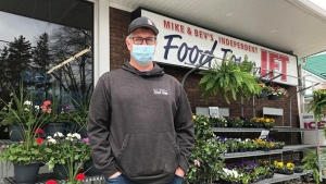 Mike Carter stands outsides of Mike and Bev's Independent Food Town on May 5, 2020. The grocery store has been his home-away-from home while his wife recovers from COVID-19. (Heather Senoran / CTV Kitchener)