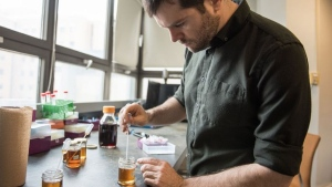 "Simon Forest is among the scientists at the Universite de Montreal's team that developed an artificial ""tongue"" made of gold that tastes maple syrup. SOURCE Amelie Philibert"