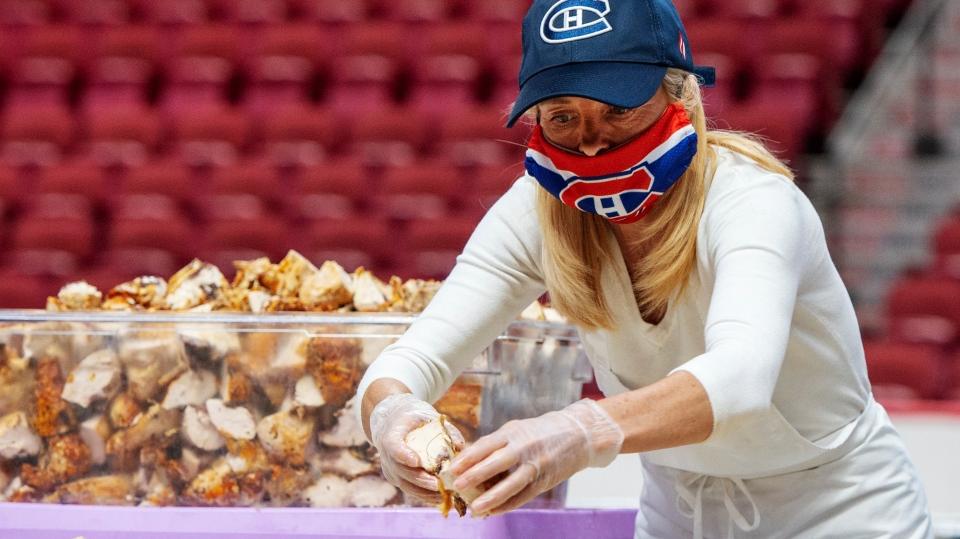Volunteer preparing meal at Bell Centre
