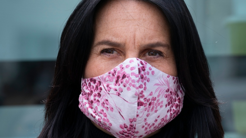 Montreal Mayor Valerie Plante wears a protective mask during a news conference in Montreal, on Tuesday, May 5, 2020. THE CANADIAN PRESS/Paul Chiasson