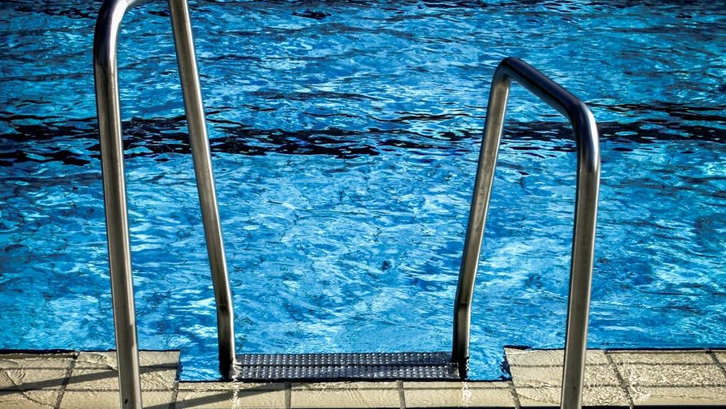 A swimming pool ladder