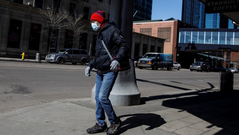 A person wears a mask to protect from COVID-19 during the world pandemic, in Edmonton Alta, on Wednesday April 8, 2020. THE CANADIAN PRESS/Jason Franson