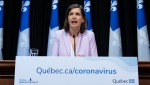 Quebec Deputy premier and Public Security Minister Genevieve Guilbault responds to reporters during a news conference on the COVID-19 pandemic at the legislature in Quebec City. THE CANADIAN PRESS/Jacques Boissinot