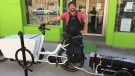 London Bicycle Café Owner Ben Cowie stands with a mobile bike repair kit in London, Ont. on Wednesday, May 6, 2020. (Bryan Bicknell / CTV London)