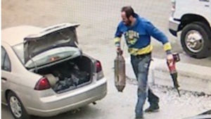 Police are searching for a suspect in connection with the theft of a catalytic convertor. (Police handout)