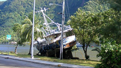 A boat from Malaloa Marina is seen on the edge of the main highway in the village of Fagatogo, in American Samoa on Tuesday, Sept. 29, 2009. (AP / Fili Sagapolutele)