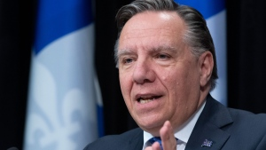 Quebec Premier Francois Legault responds to reporters questions during a news conference on the COVID-19 pandemic, Tuesday, May 5, 2020 at the legislature in Quebec City. THE CANADIAN PRESS/Jacques Boissinot