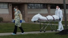 A body is wheeled from the Eatonville Care Centre, where multiple deaths from COVID-19 have occurred, in Toronto on Tuesday, April 14, 2020. The brutal assault of the novel coronavirus on long-term care facilities in Ontario has exposed long-standing, systemic problems in a sector that otherwise seldom receives top-of-mind public attention. THE CANADIAN PRESS/Nathan Denette