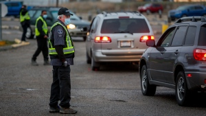 Plant security check workers returning to the Cargill beef processing plant in High River, Alta., that was closed for two weeks because of COVID-19 Monday, May 4, 2020. THE CANADIAN PRESS/Jeff McIntosh