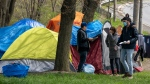 Outreach workers from The Salvation Army visit with residents of a roadside tent encampment n Toronto on Tuesday May 5, 2020. THE CANADIAN PRESS/Frank Gunn