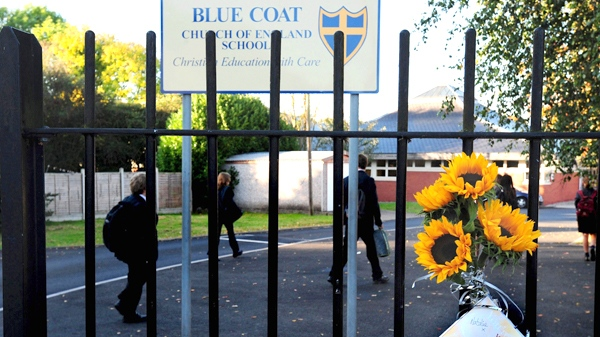 Flowers are attached to the gate of Blue Coat Church of England School in Coventry, England, on Tuesday Sept. 29, 2009. (AP / Rui Vieira, PA)