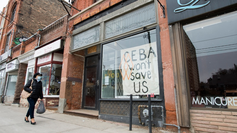 A closed store front boutique business called Francis Watson pleads for help displaying a sign in Toronto on Thursday, April 16, 2020. Prime Minister Justin Trudeau says the federal government is expanding a loan program for small businesses suffering from the COVID-19 pandemic and is working on a new support for companies having trouble paying rent. (Nathan Denette/The Canadian Press)
