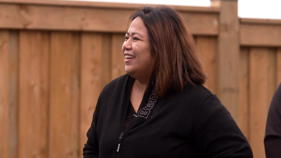 Julie Anne Cabuenas can be seen in her backyard in Bradford West Gwillimbury, Ont.