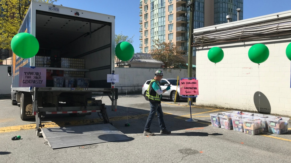 A pair of anonymous construction workers from Cressey Development Group are being credited with starting a food drive that has grown to include some 230 tradespeople helping the Greater Vancouver Food Bank during COVID-19. (CTV)