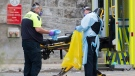 Paramedics remove their protective clothing outside the Hotel-Dieu hospital in Montreal, Sunday, May 3, 2020, as the COVID-19 pandemic continues in Canada and around the world. THE CANADIAN PRESS/Graham Hughes