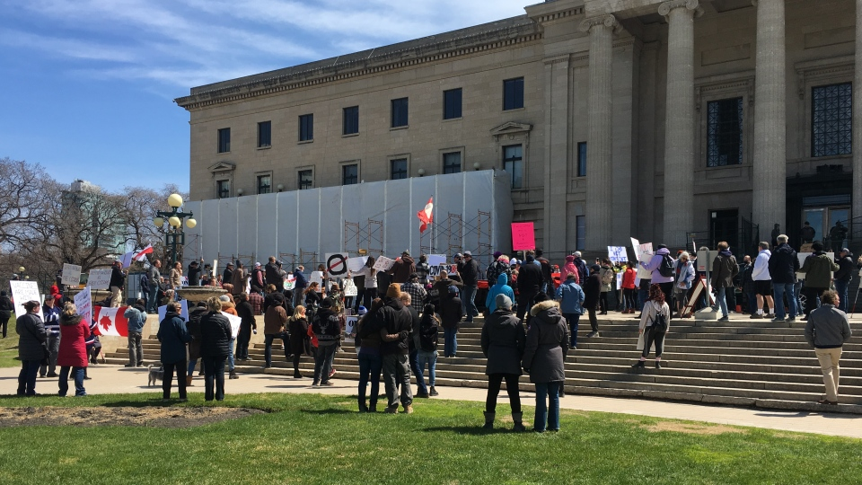 Protesters attended an anti-lockdown rally at the Manitoba Legislative Building Saturday afternoon.