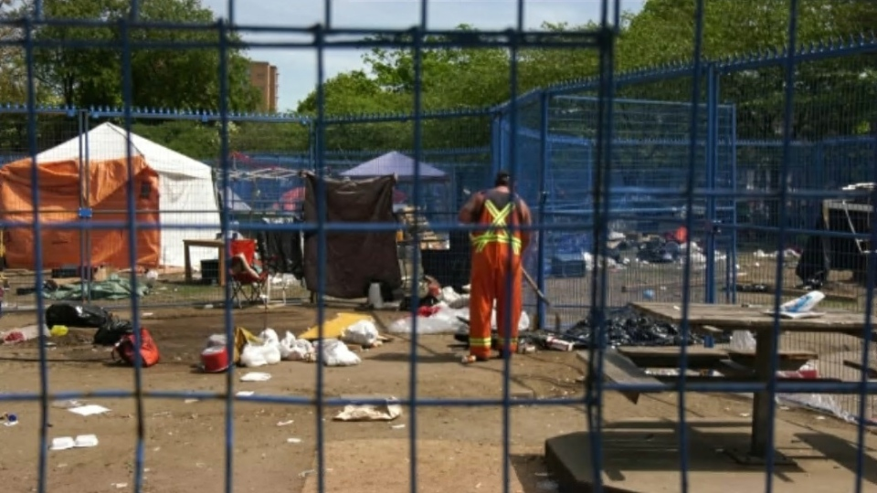 Police and City of Vancouver park rangers escorted the last person living in Oppenheimer Park out of the tent city Saturday afternoon, moments before crews with excavators moved in to clean up the mountains of trash left behind. (CTV)
