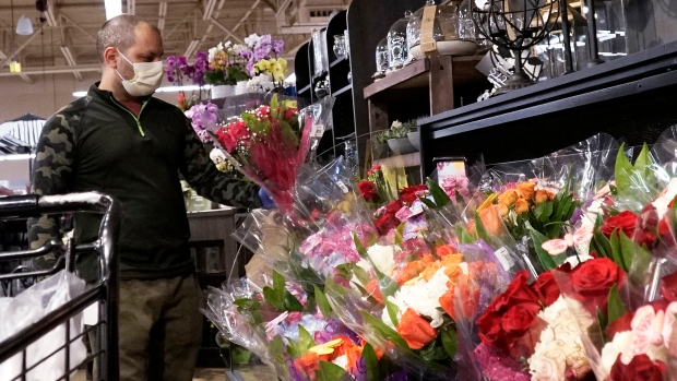 A man shops at a grocery store for flowers for Mother's Day during the COVID-19 pandemic in Northbrook, Ill., Saturday, May 9, 2020. (AP Photo/Nam Y. Huh)