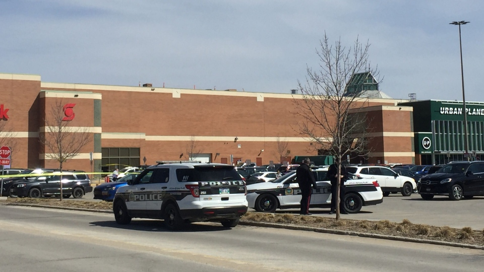Multiple police cars block off a portion of the CF Polo Park parking lot on