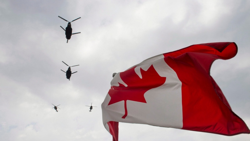 Canadian Forces CH-47 Chinook helicopters participate in a flyover of Parliament Hill in Ottawa on Friday, May 9, 2014. (THE CANADIAN PRESS/Justin Tang)