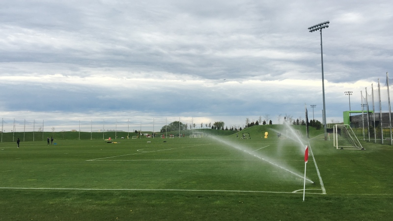 Sprinklers water Toronto FC's training grounds in Toronto in this photo from May 22, 2019. Toronto FC says it will begin voluntary individual player workouts outdoors at its north Toronto training facility starting Monday. THE CANADIAN PRESS/Neil Davidson