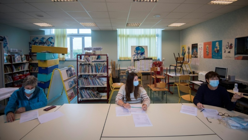 Excited children greeted their friends and weary parents got used to early starts again as schools in several European countries reopened after a nearly two-month coronavirus break. (AFP)