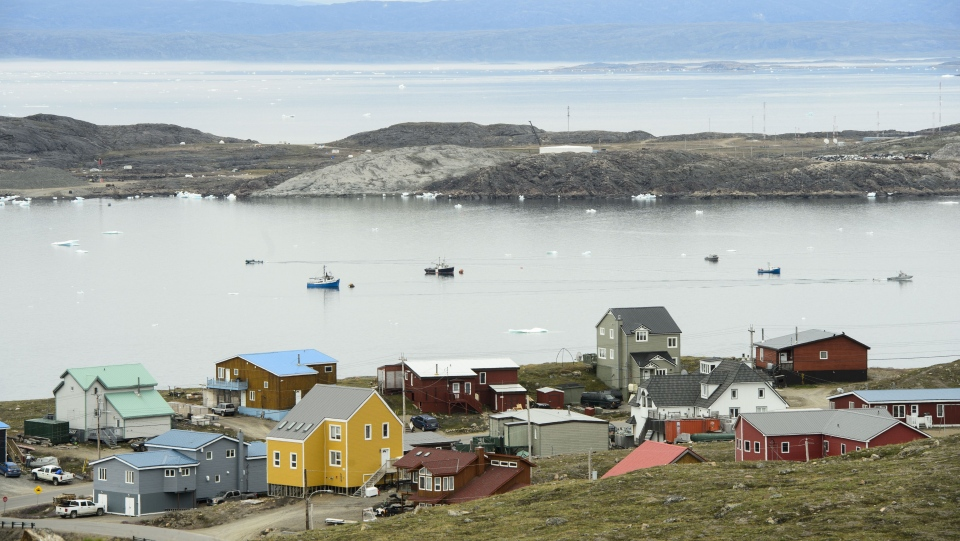 Small boats make their way through the Frobisher Bay inlet in Iqaluit on Friday, Aug. 2, 2019. THE CANADIAN PRESS/Sean Kilpatrick