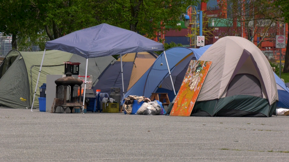 Tents are seen in the parking lot of CRAB Park in Vancouver on Saturday, May 9, 2020.