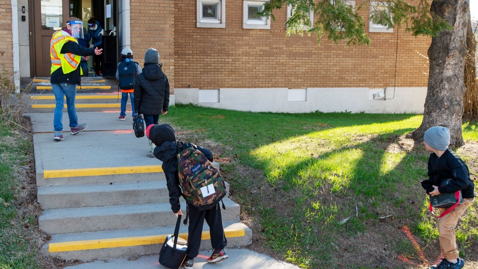 Students maintain social distancing at Ecole Marie Rose as elementary schools outside the greater Montreal area reopen Monday May 11, 2020 in Saint Sauveur, Que.. Schools and daycare centers have been closed due to the COVID-19 pandemic. THE CANADIAN PRESS/Ryan Remiorz