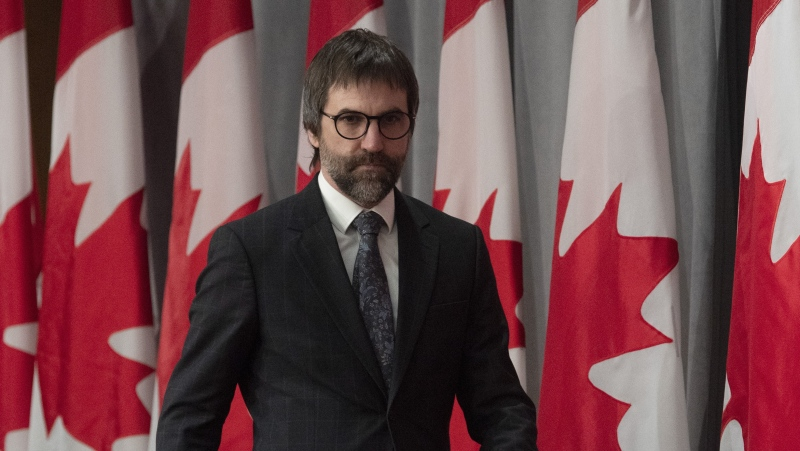 Minister of Canadian Heritage Steven Guilbeault makes his way to his seat for a news conference in Ottawa, Friday, April 17, 2020. (THE CANADIAN PRESS/Adrian Wyld)