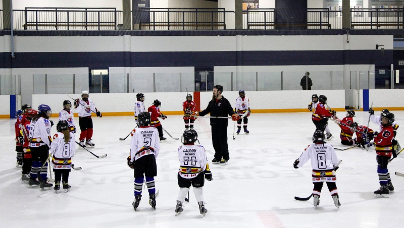 Children take instruction during a practice session in Calgary, Alta. Minor hockey associations across Canada have had to cut their seasons due to the COVID-19 pandemic, and many of them are trying to determine when they will resume and how to make the game safe for children. (File photo: THE CANADIAN PRESS/Jeff McIntosh)