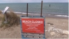 A beach closed sign is seen in Kincardine, Ont. on Tuesday, May 12, 2020. (Scott Miller / CTV London)