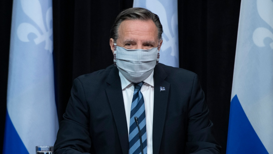 Quebec Premier Francois Legault arrives at a news conference on the COVID-19 pandemic wearing a mask, Tuesday, May 12, 2020 at the legislature in Quebec City. THE CANADIAN PRESS/Jacques Boissinot