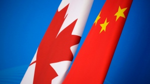 Flags of Canada and China are placed for the first China-Canada economic and financial strategy dialogue in Beijing, China, Monday, Nov. 12, 2018. THE CANADIAN PRESS/Jason Lee/Pool Photo via AP